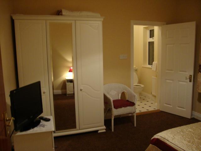 Double En-Suite Room  with Wardrobe, Chair, TV -opening into En-Suite.
