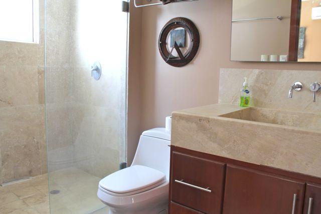 Large tiled shower in second bathroom.