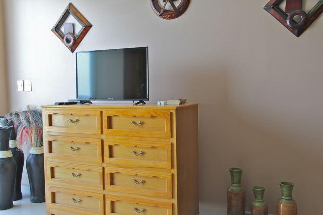 Dresser and flat-screen Tv in third bedroom.