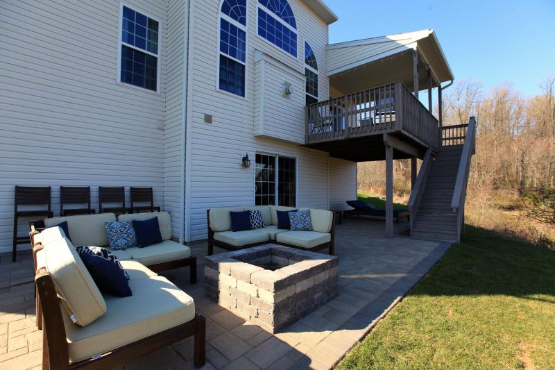 Patio and firepit with seating for 12.  Basement access.