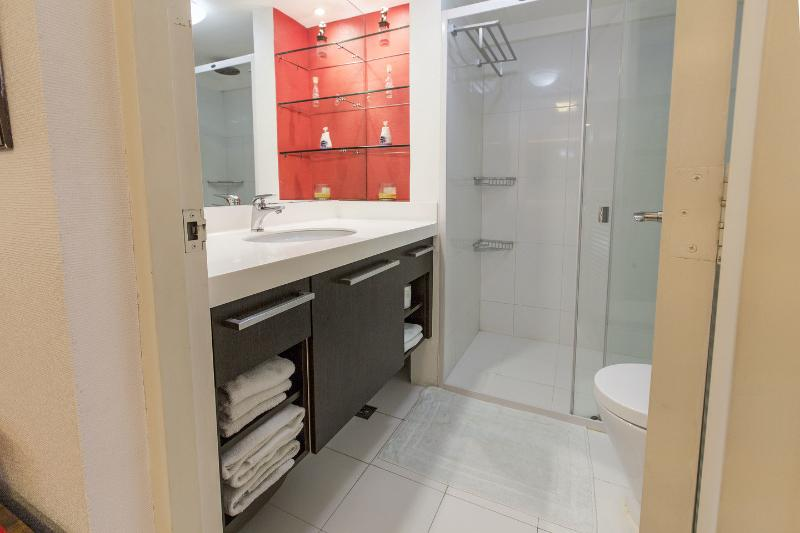 Bathroom counter, walk-in shower with complimentary shampoo & soap, red toiletry niche...