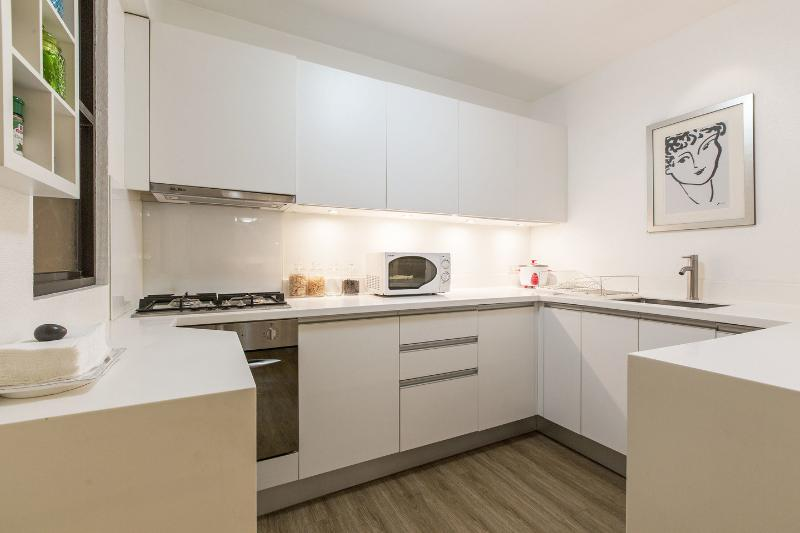 Built-in German designer kitchen, fully equipped with 4-top gas & electric burners, oven, exhaust...