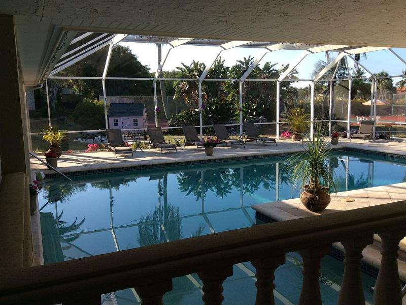 Beautiful large pool and covered lanai area