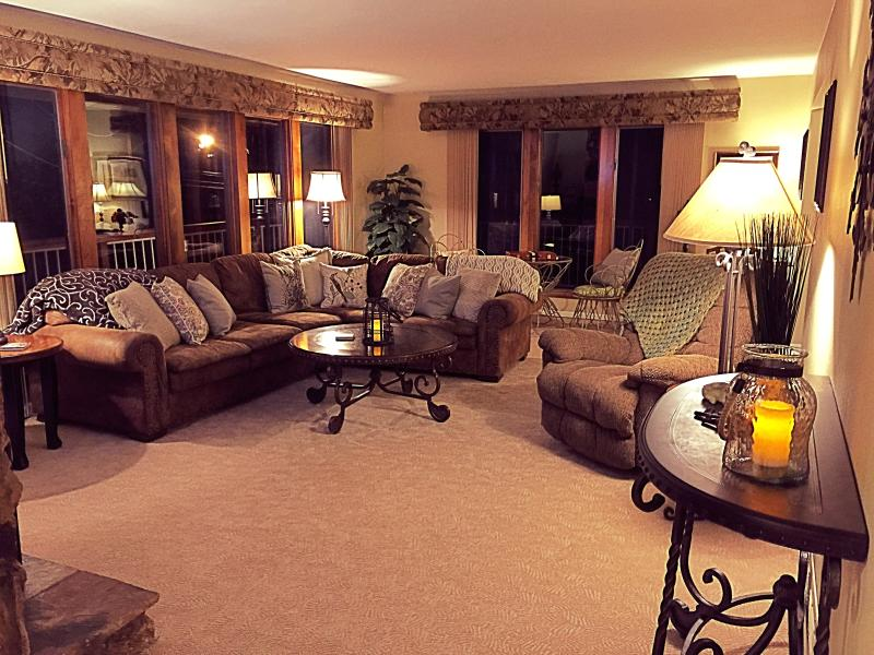 The large and cozy family room at night.