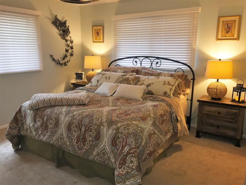 Spacious master bedroom with flat-screen tv.  In suite bathroom with double sink & marble countertop