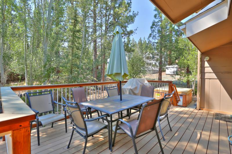 Large deck just off of the kitchen for dining alfresco!  Gas BBQ grill and adjacent jacuzzi.
