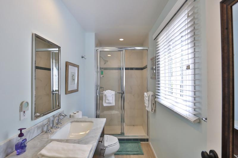 Master bathroom with double sinks, marble counter tops and good sized shower.