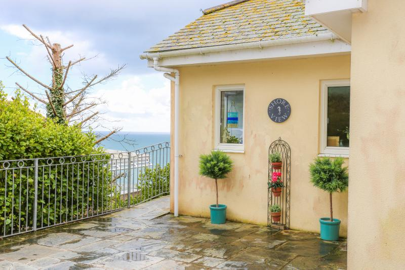 Entrance to house, with spectacular views across the beach.