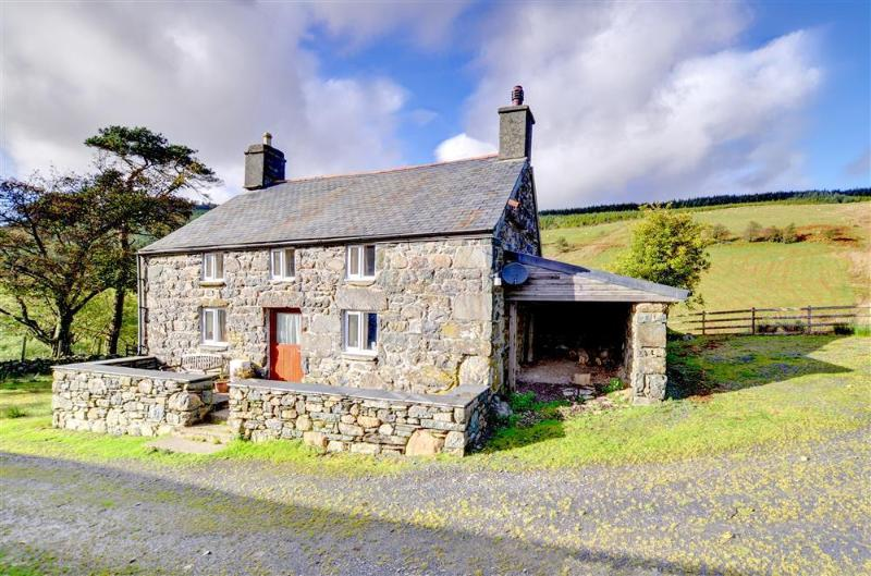 This attractive stone former farmhouse stands in a secluded location at the head of a valley north of Dolgellau