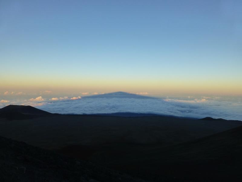 Turn around and watch the shadow of Mauna Kea over the Pacific Ocean.