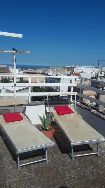 Sun loungers on roof terrace