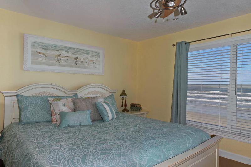 Master with direct ocean front window - King Bed with flat screen tv and full shower bath