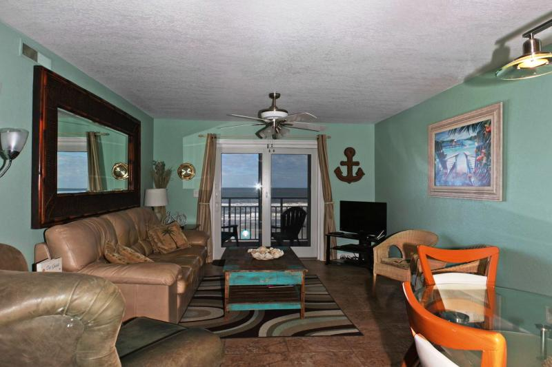 Living room with direct ocean front balcony.  Seating for 6 with Lazy Boy chair, Full Size sleeper