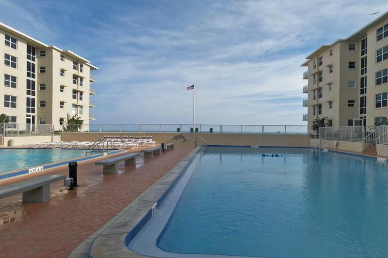 2 large pools, one seasonally heated, with 2 kiddie wading pool, shuffle board and community grill