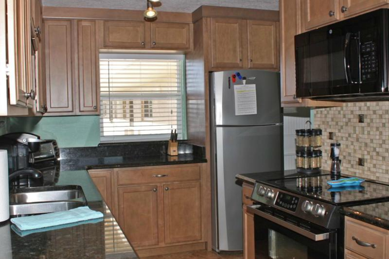 FULLY LOADED kitchen.  Microwave, stove top and oven, dishwasher, crockpot, Keurig and standard drip