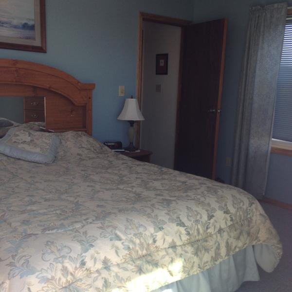 Large queen sized bed for comfort.  TV with cable in room.