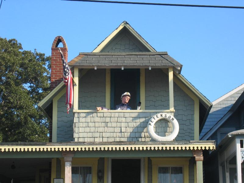 Captain looking out on the Oak Bluffs harbor Gingerbread Cottage