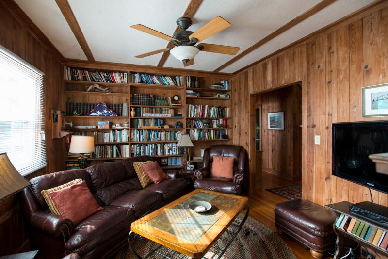 Cozy library with fireplace and flatscreen