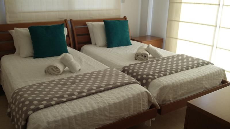 Bedroom 3 has 2 large single beds and a full ensuite bathroom