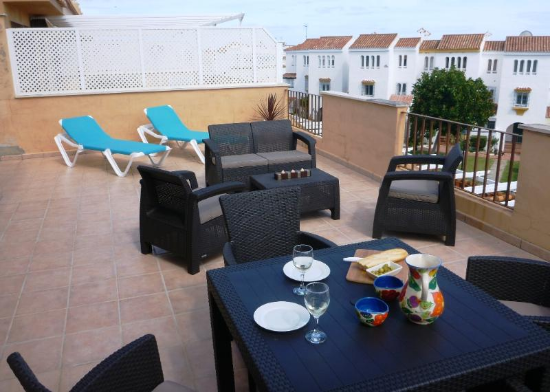 Over-sized terrace with separate leisure areas.
