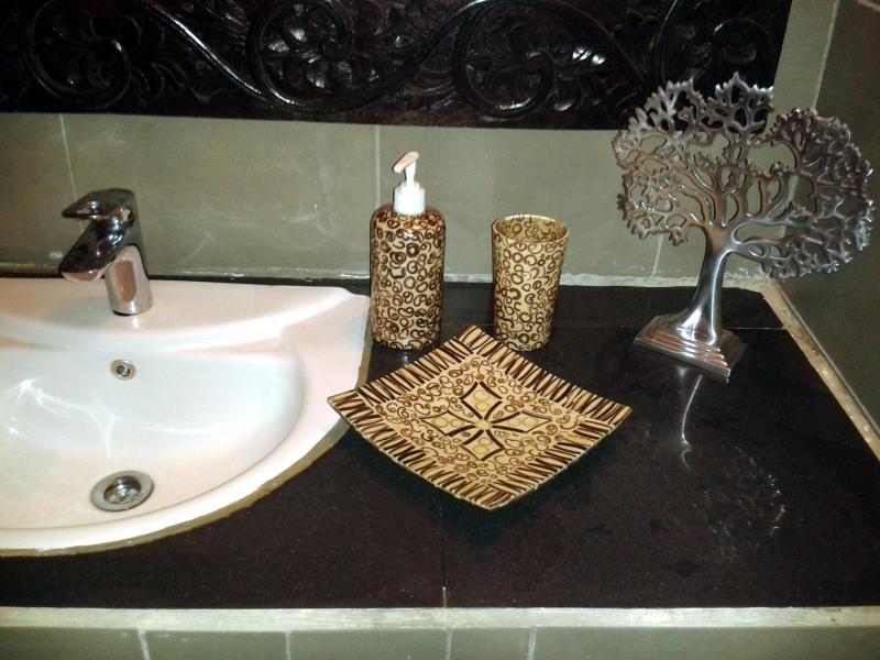 Bathroom detail showing granite sink area
