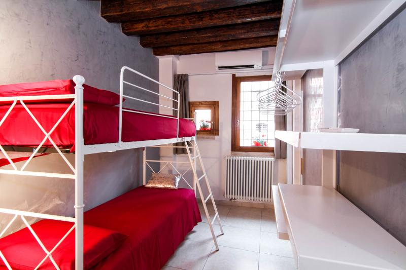 The bedroom with bunk bed and bathroom inside