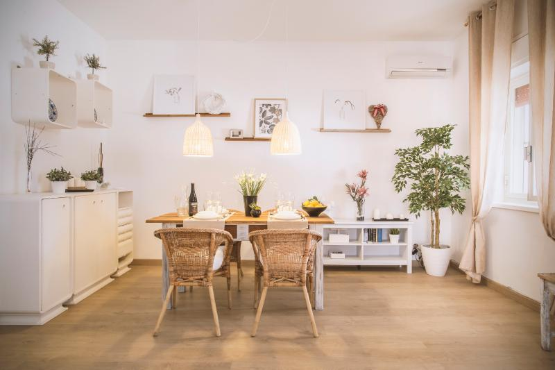 The spacious living with dining table in a modern rustic style