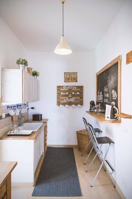The kitchen, separate from dining room, fully equipped