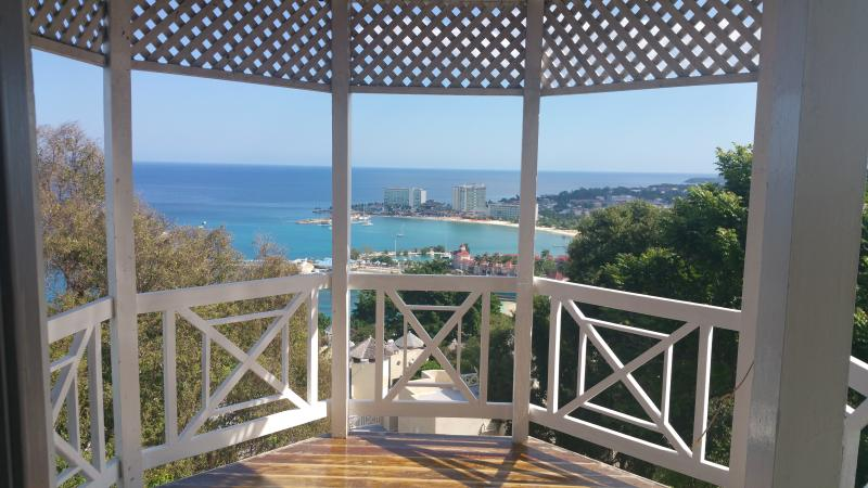 Enjoy this breath-taking view of the Ocho Rios Bay from your private gazebo styledo patio.