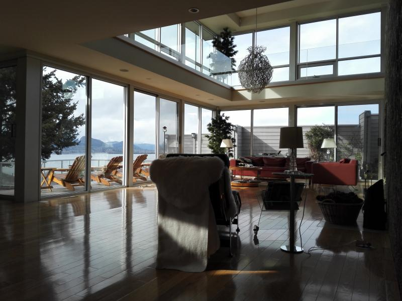 Modern architecture has many huge windows for great views on Okanagan Lake, mountains and Penticton.