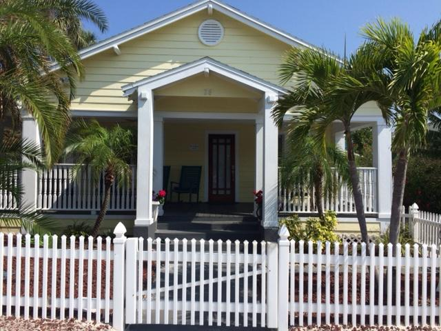 Old Florida Charm!  The front porch is surrounded by Tropical landscaping, and a gorgeous view.