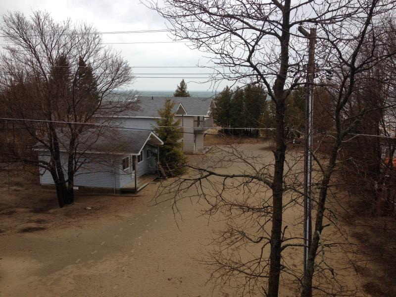 view from upper deck of other rental cottages on property