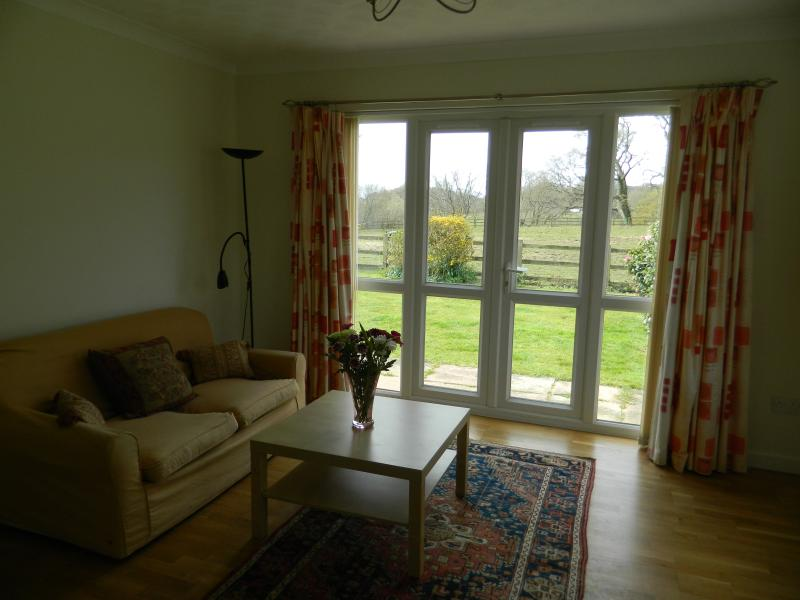 Living room with view of paddock