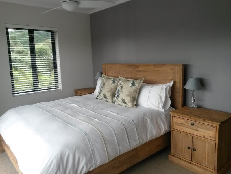 Main bedroom en-suite, King size bed, leading onto patio with panoramic river views