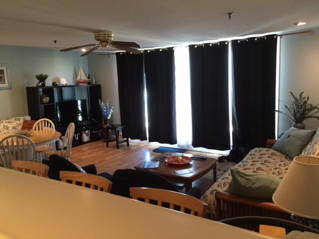 large living room with 2 queen size couch and futons