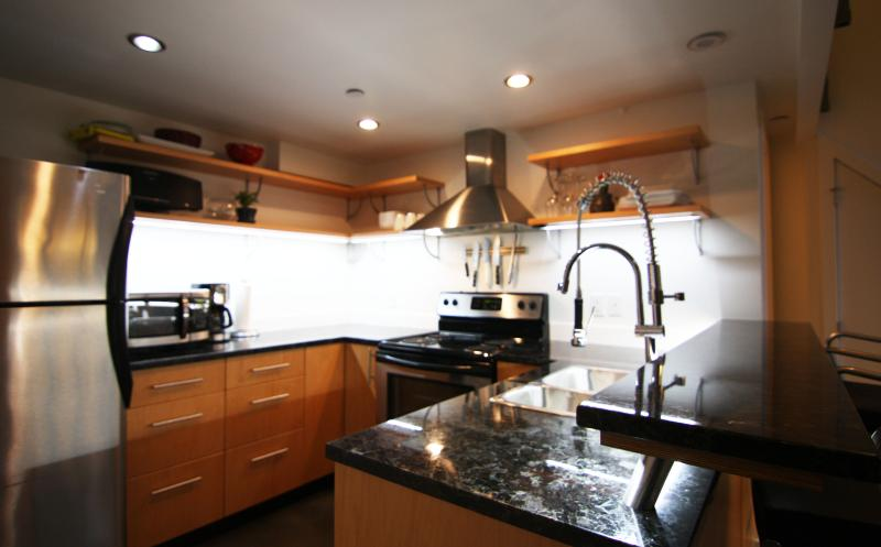 led lights and granite make for a clean and functional kitchen.