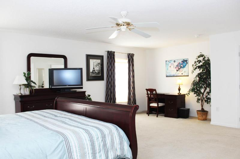 Master bedroom includes office desk area