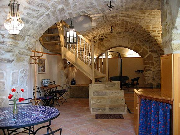 Ground floor medieval stone vaulting.
