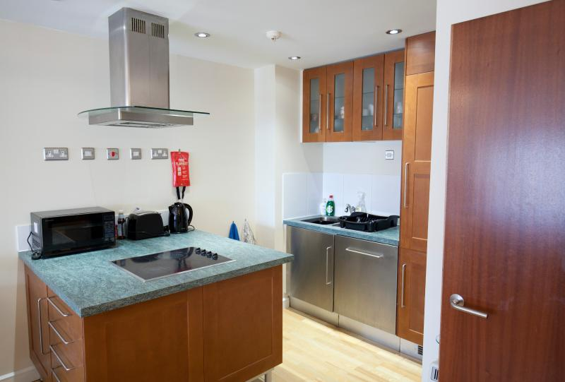 The fully equipped kitchen, including dishwasher.