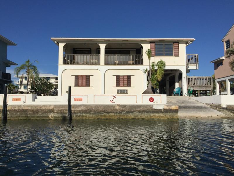 View from Canal; Very Large Porch; 80ft Step  down Seawall