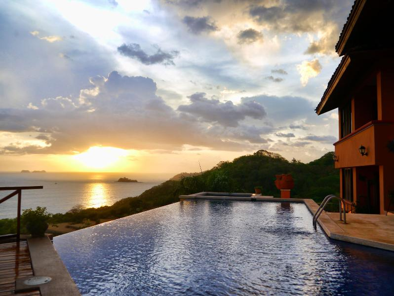 Infinity pool with stunning sunset ocean view