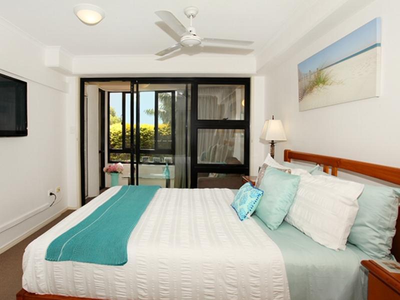 Main Bedroom with QS bed , TV , Overhaed fan .