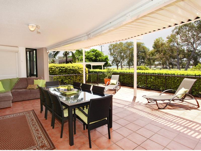 Large patio area with 8 Seater table , Corner sofa under cover to relax on plus Sunlounges