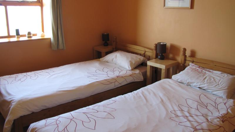 Second bedroom is a twin single bedroom - with sea view.