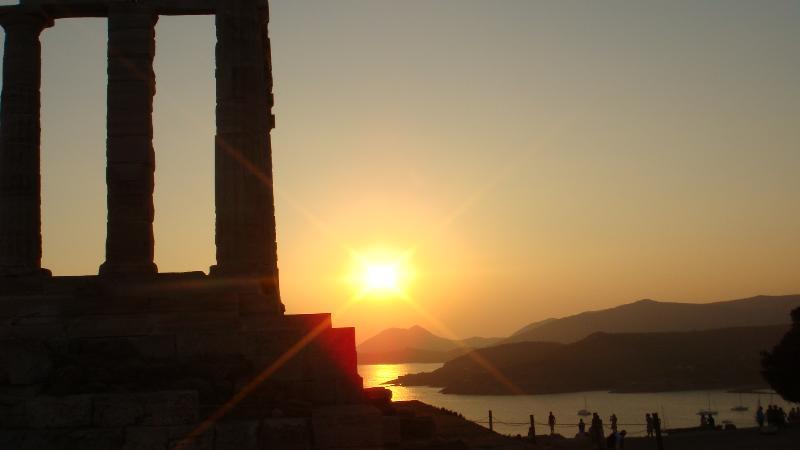 Temple of Poseidon,Sounio;below the sun is Patroklas island,exactly opposite Charakas beach