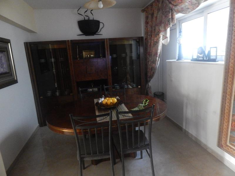 There is a dining room right opposite to the kitchen.