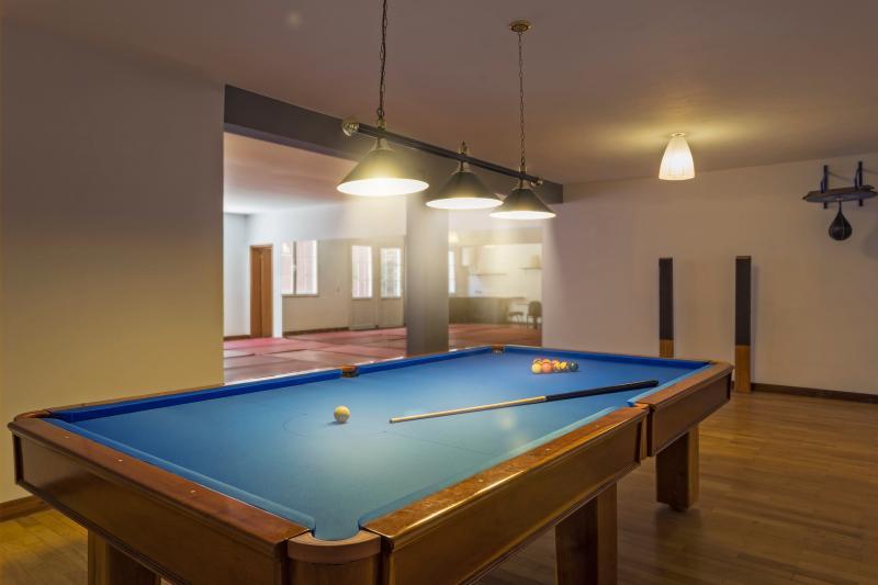 Pool table and yoga mats