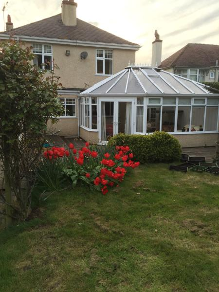 Back of house. Conservatory leading on to the deck.