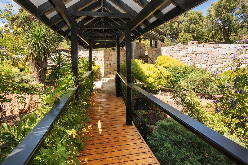 Walk across the bridge over the lush tropical gardens as Pearl River House