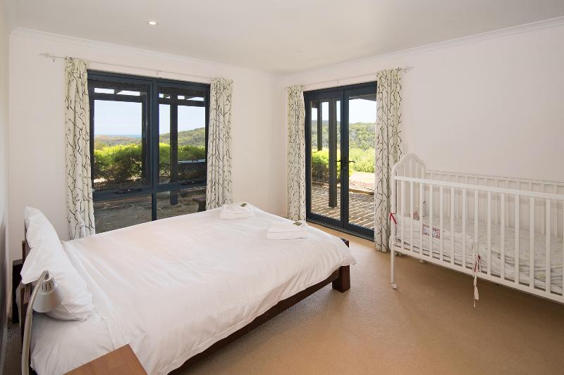 The Queen bedroom looks out to the view and has room for a cot if required at Pearl River House